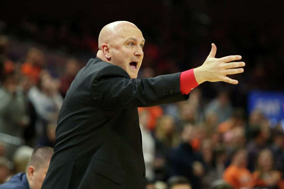 CHARLOTTESVILLE, VA - DECEMBER 18: Head coach Geno Ford of the Stony Brook Seawolves reacts to a play in the first half during a game against the Virginia Cavaliers at John Paul Jones Arena on December 18, 2019 in Charlottesville, Virginia. (Photo by Ryan M. Kelly/Getty Images)
