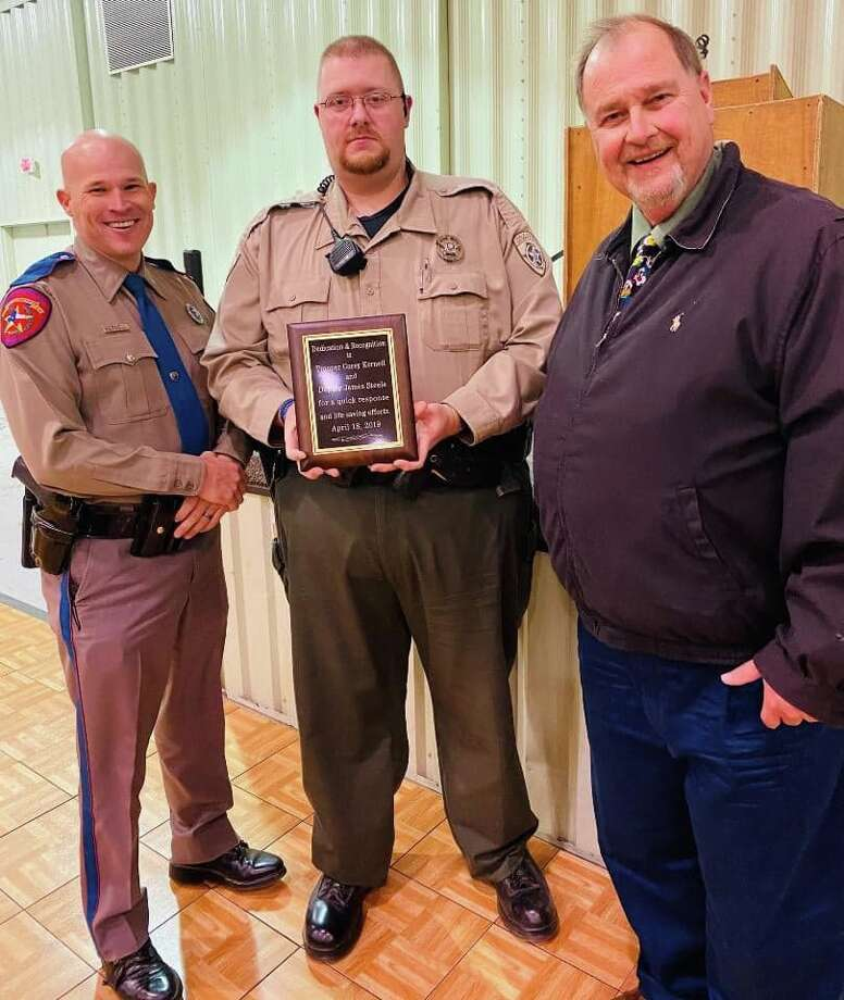 Hale County Judge David Mull recognized the heroic actions of a local Texas Department of Public Safety Trooper and a Hale County Sheriff's Deputy during an employee appreciation luncheon in December. Trooper Corey Kernell and Deputy James Steele responded to a scene at the Hale County Wind Farm in April where a 26-year-old woman fell more than 50 feet inside a windmill. She sustained severe injuries and was transported to a Lubbock hospital via Aerocare. Kernell and Steele were recognized for their actions by the state in October. Since Steele is a Hale County employee, the two heroes were honored again. Mull presented them with a special plaque that now hangs inside the Hale County Sheriff's Office. Photo: Ida Tyler/Courtesy Photo