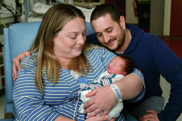 Norwalk residents Christine and Jason Bocuzzo with their newborn son, Owen Christopher Bocuzzo, Thursday, January 2, 2020, at Norwalk Hospital in Norwalk, Conn. Owen Christopher Bocuzzo was born at 11:30am on New Year's Day at 5 lbs., 9 oz. and 18.5 in. long.