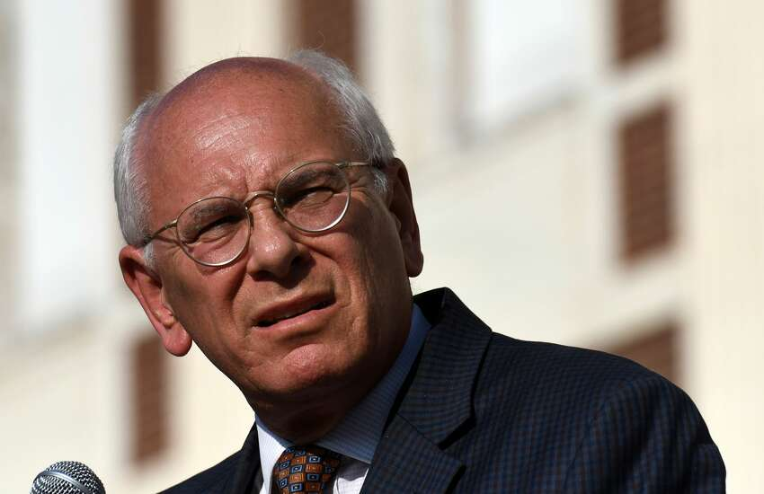 U.S. Rep. Paul Tonko speaks during a vigil held outside Schenectady City Hall to pay tribute to the victims of the mass shootings in El Paso, Texas, and Dayton, Ohio on Friday afternoon, Aug. 9, 2019, in Schenectady, N.Y.