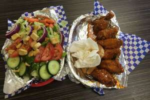 A salad and an order of Texas Honey Bee wings from Wayne's Wings