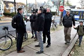 New Haven, Connecticut - Thursday, January 2, 2020: New Haven Mayor Justin Elicker talks with the press Thursday morning after walking his daughter Molly, 5, to the school bus stop on the corner of Orange Ave. and Canner St. in New Haven before riding his bicycle to New Haven City Hall on his first day on the job as Mahor.