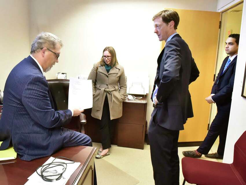 New Haven, Connecticut - Thursday, January 2, 2020: Sean Matteson, chief of staff for New Haven, left, with his boss. Mayor Justin Elicker, third from left, and Rebecca Bombero, director of New Haven Parks, Recreation and Trees, second from left, and Gage Frank, Elicker's director of communications, far right, in Matteson's City Hall office Thursday on Elicker's first day in office.