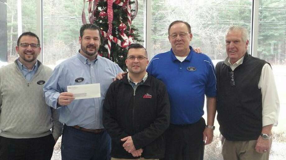 """Representatives of Betten Baker Buick GMC Cadillac Midland and the Midland American Legion pose together celebrating Betten Baker's $1,500 donation to the American Legion's """"Christmas basket"""" program. From left, sale manager Chris Daniel and operations manager Kevin Sheridan of Betten Baker; Midland American Legion Commander James Cherry; Don Furgeson, Betten Baker sales; and Nels Cronkright, Midland American Legion 2nd vice commander and American Legion state baseball director. (Photo provided/Ross Ahlich)."""