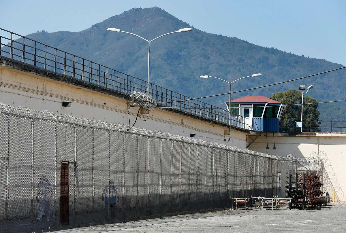 """Mount Tamalpais rises above San Quentin State Prison in San Quentin, Calif. on Thursday, Sept. 12, 2019. The Robert E. Burton Adult School at the prison has been designated as a """"distinguished school,"""" the first school within the California corrections system to achieve the honor."""