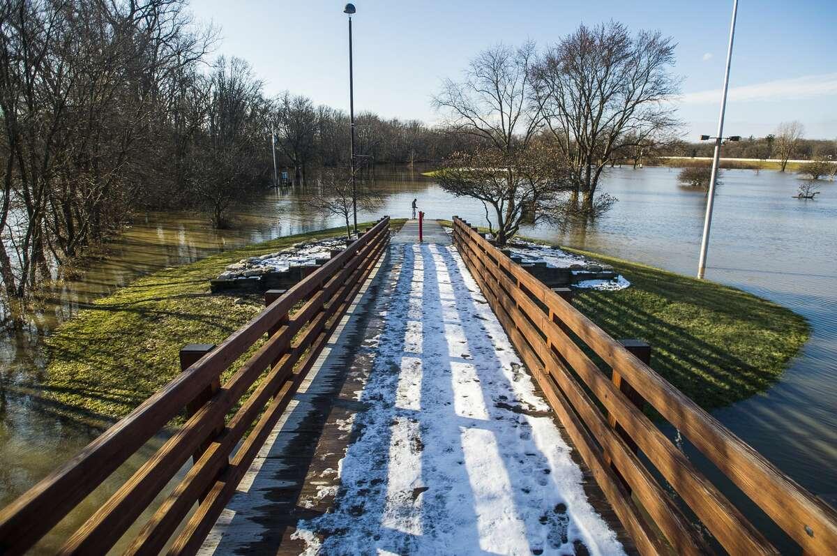 One leg of the Tridge has become an island in Chippewassee Park due to flooding Thursday, Jan. 2, 2020. (Katy Kildee/kkildee@mdn.net)