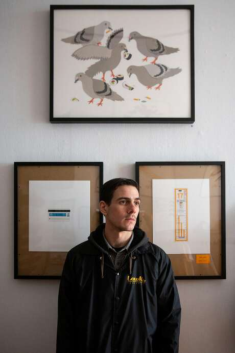 Austen Zombres at LowKey skate shop in S.F., with his collages behind him. Photo: Santiago Mejia / The Chronicle 2019