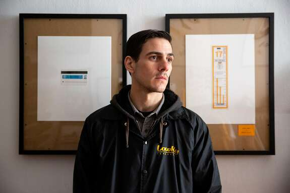 A portrait of Austen Zombres next to his work at LowKey skate shop on Wednesday, Dec. 18, 2019, in San Francisco, Calif. Zombres is an artist who makes trash into art.