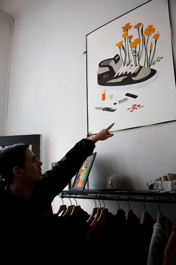 Austen Zombres points to one of his collage artworks at LowKey skate shop in S.F. Photo: Santiago Mejia / The Chronicle