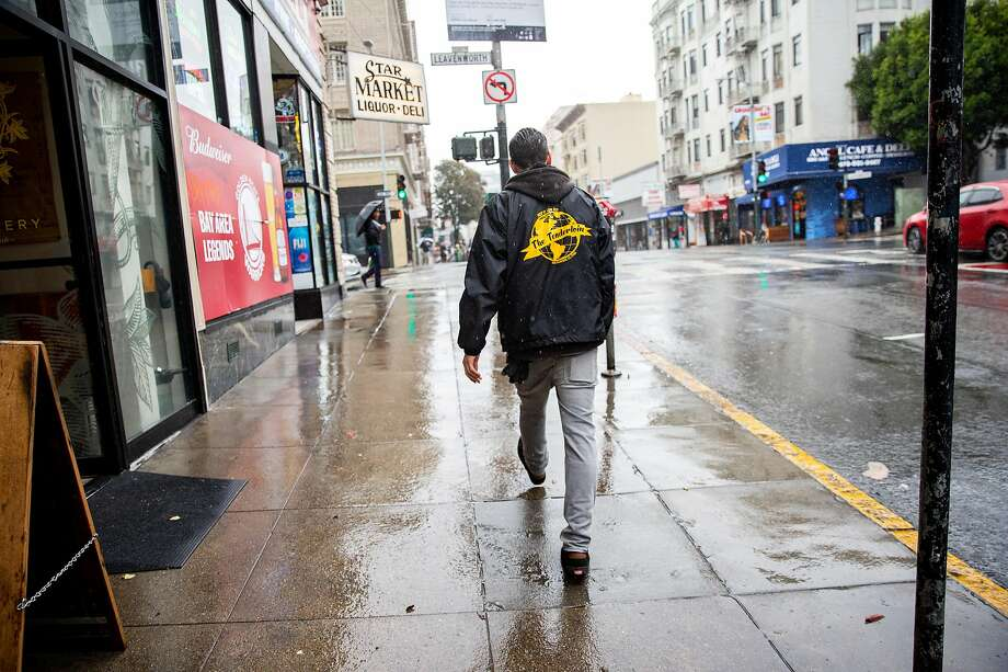 Austen Zombres in S.F.'s Tenderloin, where the artist has been known to collect collage materials, stopping at liquor stores to request their trash, specifically cigarette cartons, which display certain colors. Photo: Santiago Mejia / The Chronicle