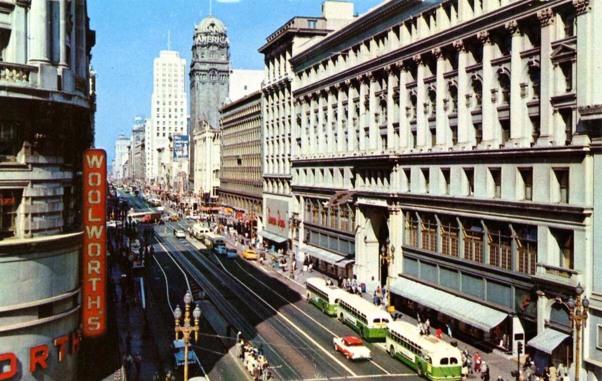 1957 - SAN FRANCISCO: Vintage postcard showing one of the widest thoroughfares in the country, San Francisco's Market Street. Busses and vintage automobiles travel the street and Woolworth's is visible on the left. (Photo by Lake County Museum/Getty Images)