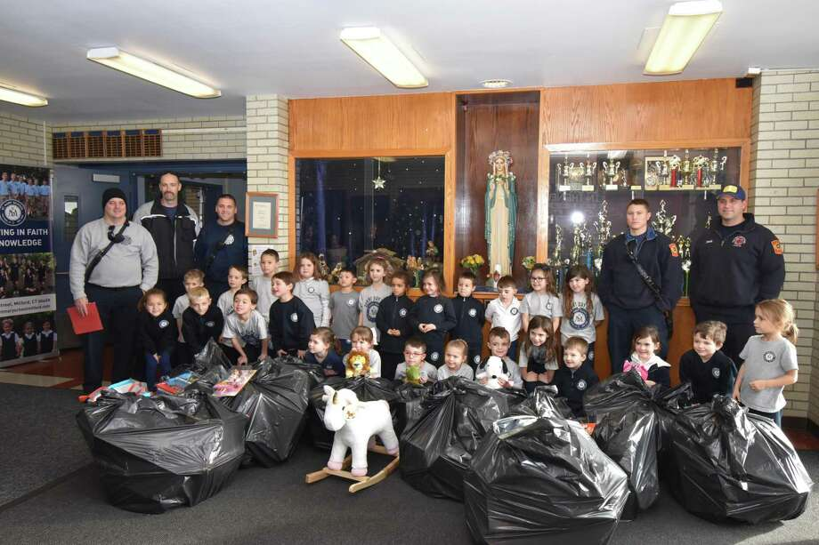 St. Mary School students and families donated toys to this year's Toys for Tots collection. St. Mary School has beendonating to the organization formore than 20 years. Photo: Contributed Photo