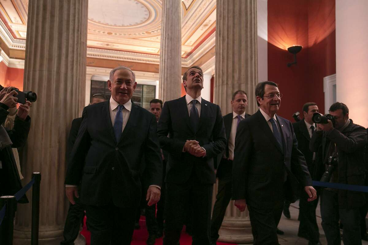Israeli Prime Minister Benjamin Netanyahu, left, Greece's Prime Minister Kyriakos Mitsotakis, center, and Cypriot President Nicos Anastasiadis arrive for a signing ceremony at Zappeio hall, in Athens, Thursday, Jan. 2, 2020. The leaders of Greece, Israel and Cyprus met in Athens Thursday to sign a deal aiming to build a key undersea pipeline, named EastMed, designed to carry gas from new rich offshore deposits in the southeastern Mediterranean to continental Europe. (AP Photo/Yorgos Karahalis)