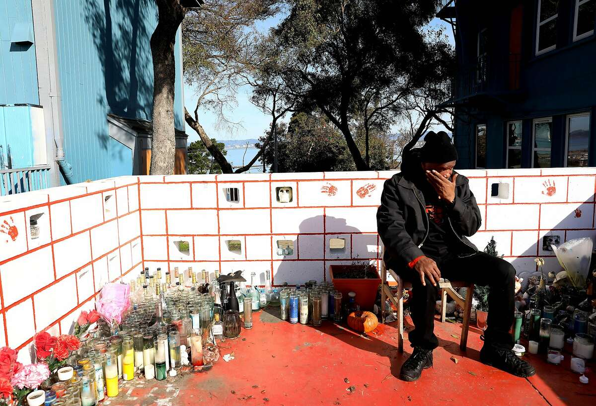 Guy Hudson, a Street Violence Intervention Program (SVIP) crisis manager, wipes his eyes while he remembers a former mentee, Matthew Higginbotham, 23, who was fatally shot in the Hunter's Point neighborhood in July 2018, as he and his team patrol the area in San Francisco, Calif., on Thursday, January 2, 2020. Hudson stated the young man was sitting in a vehicle when the shooting occurred. SVIP has helped intervene in neighborhood trouble, driving down violence and homicides in San Francisco to an all time low in 2019.
