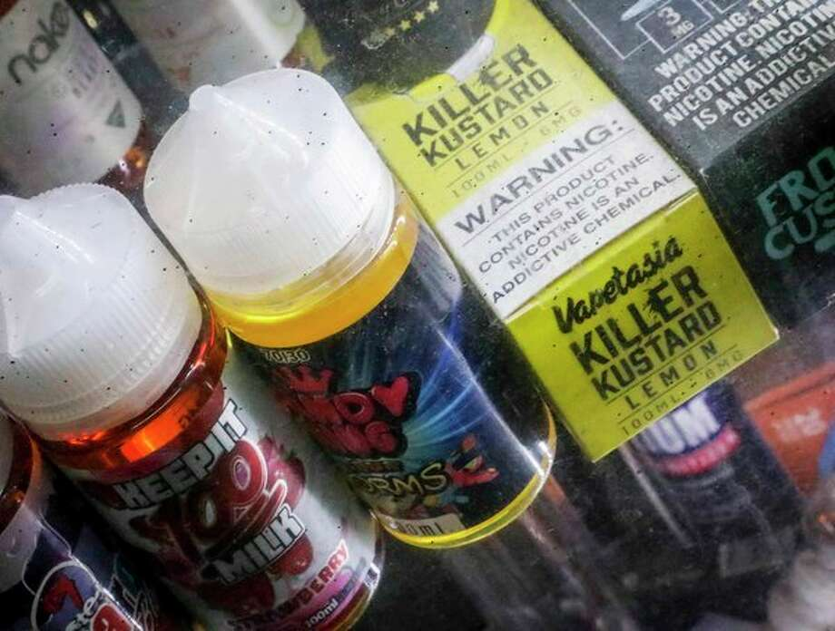 The Trump administration announced that it will prohibit fruit, candy, mint and dessert flavors from small, cartridge-based e-cigarettes that are popular with high school students, but the flavor ban will also entirely exempt large, tank-based vaping devices, which are primarily sold in vape shops that cater to adult smokers. (AP Photo/Bebeto Matthews, File) / Copyright 2019 The Associated Press. All rights reserved.