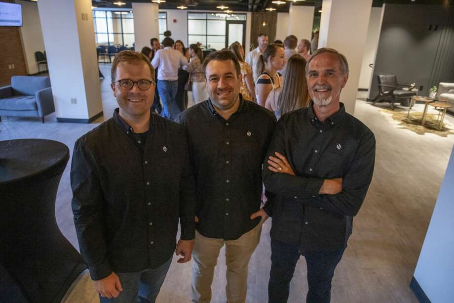 Joe Aylor, Brian Davis and Darrall Dunton the owners of Second Story Coworking at the grand opening party on July 18, 2019 at Second Story Coworking. Jacy Lewis/Reporter-Telegram Photo: Jacy Lewis/Reporter-Telegram