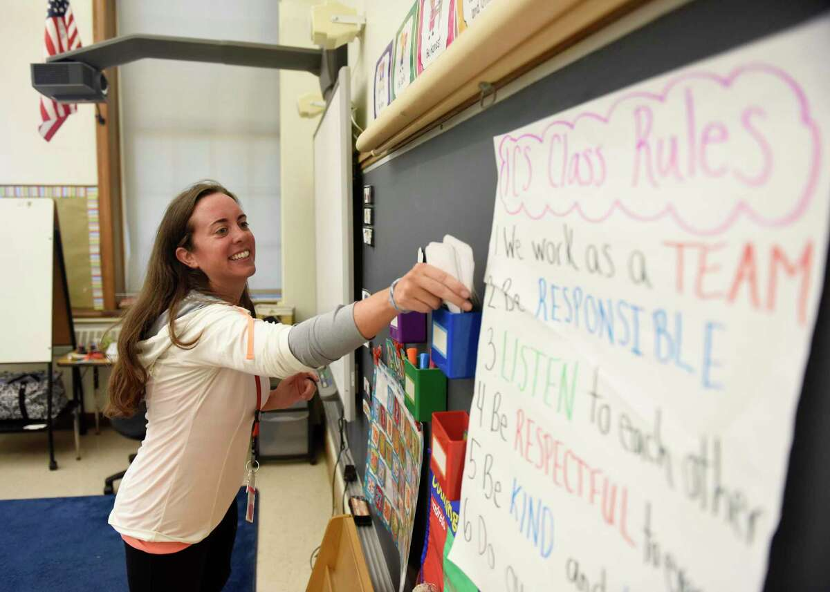 First grade teacher Colleen Sexton sets up her classroom in preparation for the first day of school at Julian Curtiss School in Greenwich, Conn. Monday, Aug. 27, 2018. What will teachers need to do to prepare for the first day of school in 2020?