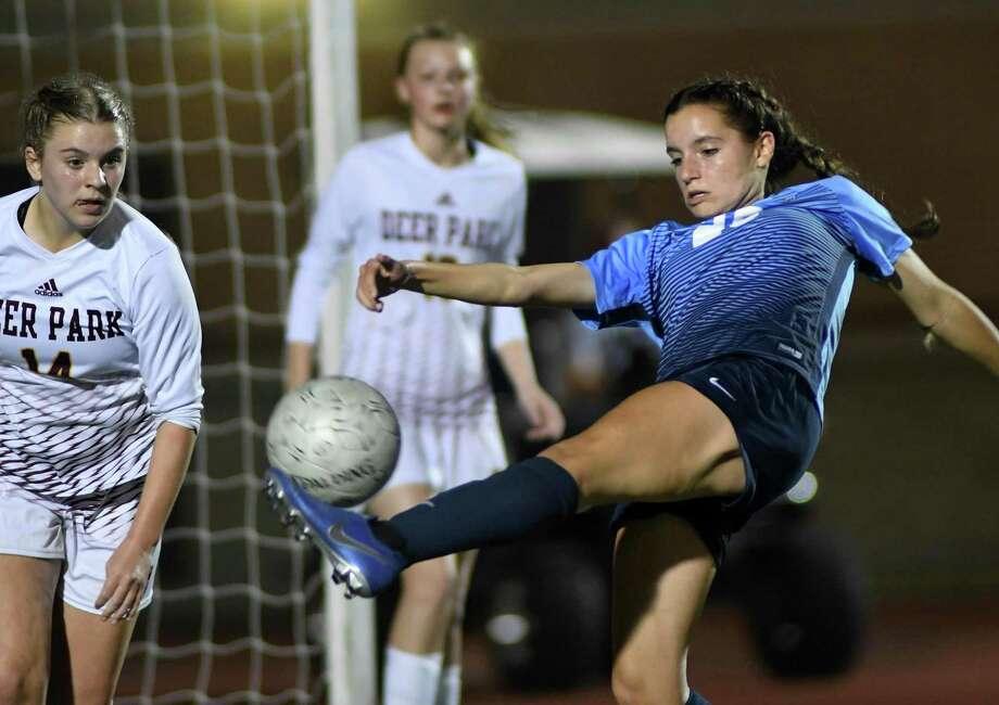 Kingwood junior Emma Ebert, right, gives an all-out effort for a shot on goal against the Deer Park defense during the second half of their UIL Region III-6A Regional Quarterfinal State Soccer Playoff matchup at Turner Stadium in Humble on April 5, 2019. Photo: Jerry Baker, Houston Chronicle / Contributor / Houston Chronicle