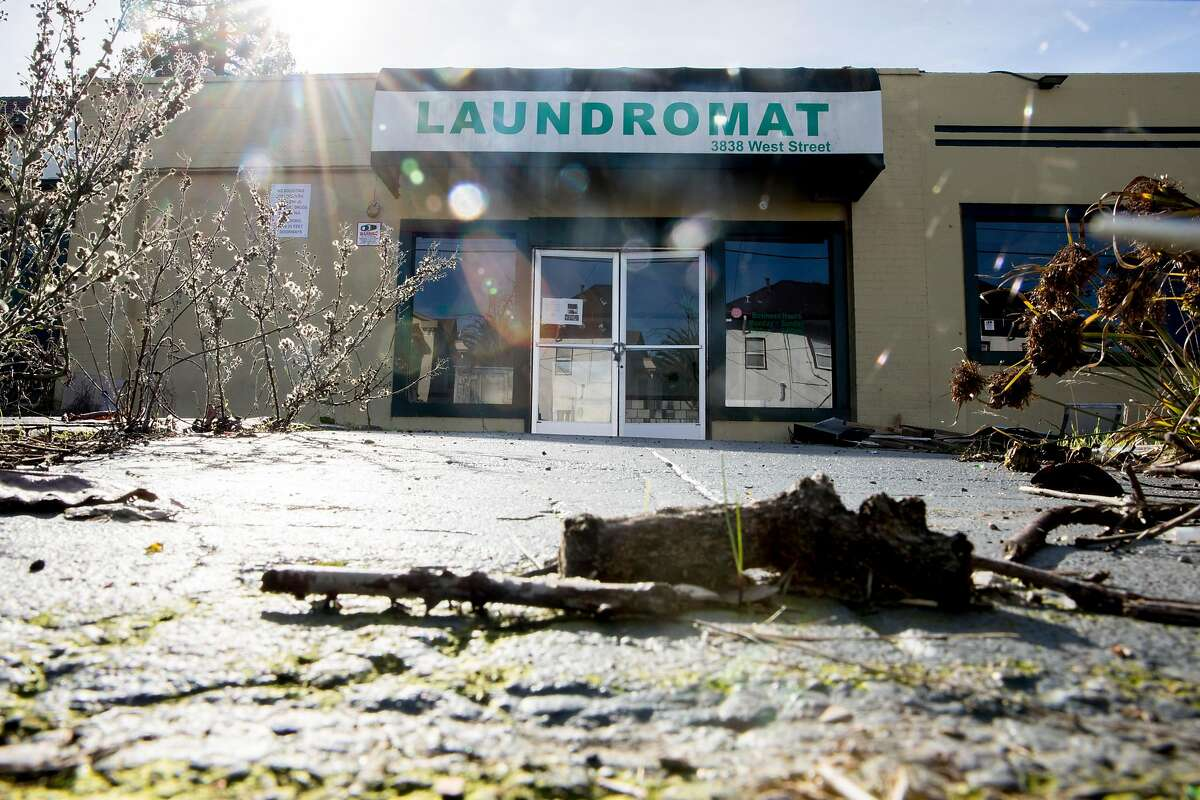 A laundromat is seen closed before being remodeled near the corner of West and Apgar streets in Oakland, Calif. Thursday, January 2, 2020 where a warehouse fire broke out in the early morning hours of Friday, Dec. 27, 2019.