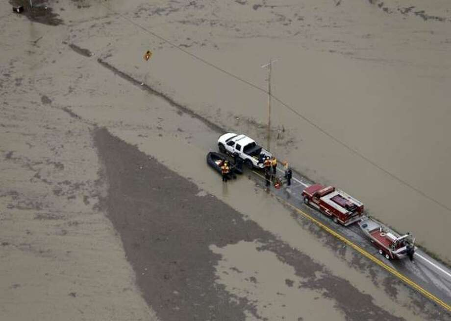 In this December 2015 file photo, rescue personnel stage in West Alton, Missouri. Photo: Jeff Roberson   AP File Photo