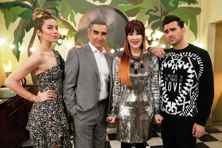 """This image released by Pop TV shows, from left, Annie Murphy, Eugene Levy, Catherine O'Hara and Dan Levy from the series """"Schitt's Creek."""" The comedy series was named one of the top ten TV shows of the year by the Associated Press. (Pop TV via AP) / Pop TV"""