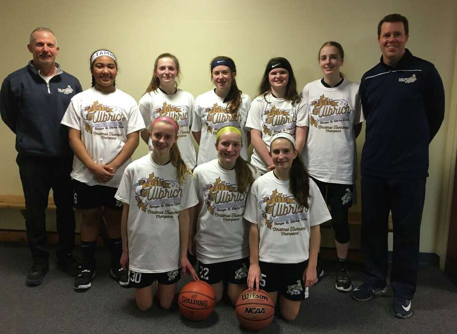 The Milford Knights 8th grade girls travel basketball team swept its way to the title. Team members (front row) are Faith Doyle, Abby Savoie and Maya Pinto; (second row) coach Mike Donegan, Tiffany Rosado, Maggie Wetmore, Erin Donegan, Zoe Johnson, Chloe Haasch and coach Trevor Doyle. Photo: Contributed Photo / Milford Knights / Milford Mirror