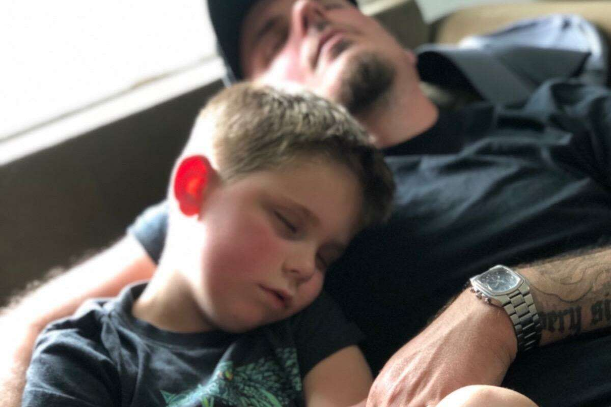 East Haven 7-year-old Trenton O'Brien and his father, Tim, get some down time at home during Trenton's continuing fight against a rare and nearly always fatal tumor.
