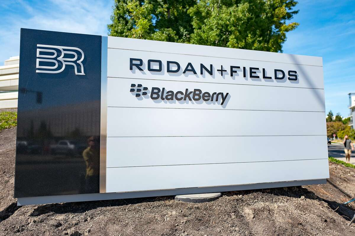 Close-up of sign with logos for Rodan and Fields and Blackberry at the Bishop Ranch office park in San Ramon, California, September 26, 2018. ~~