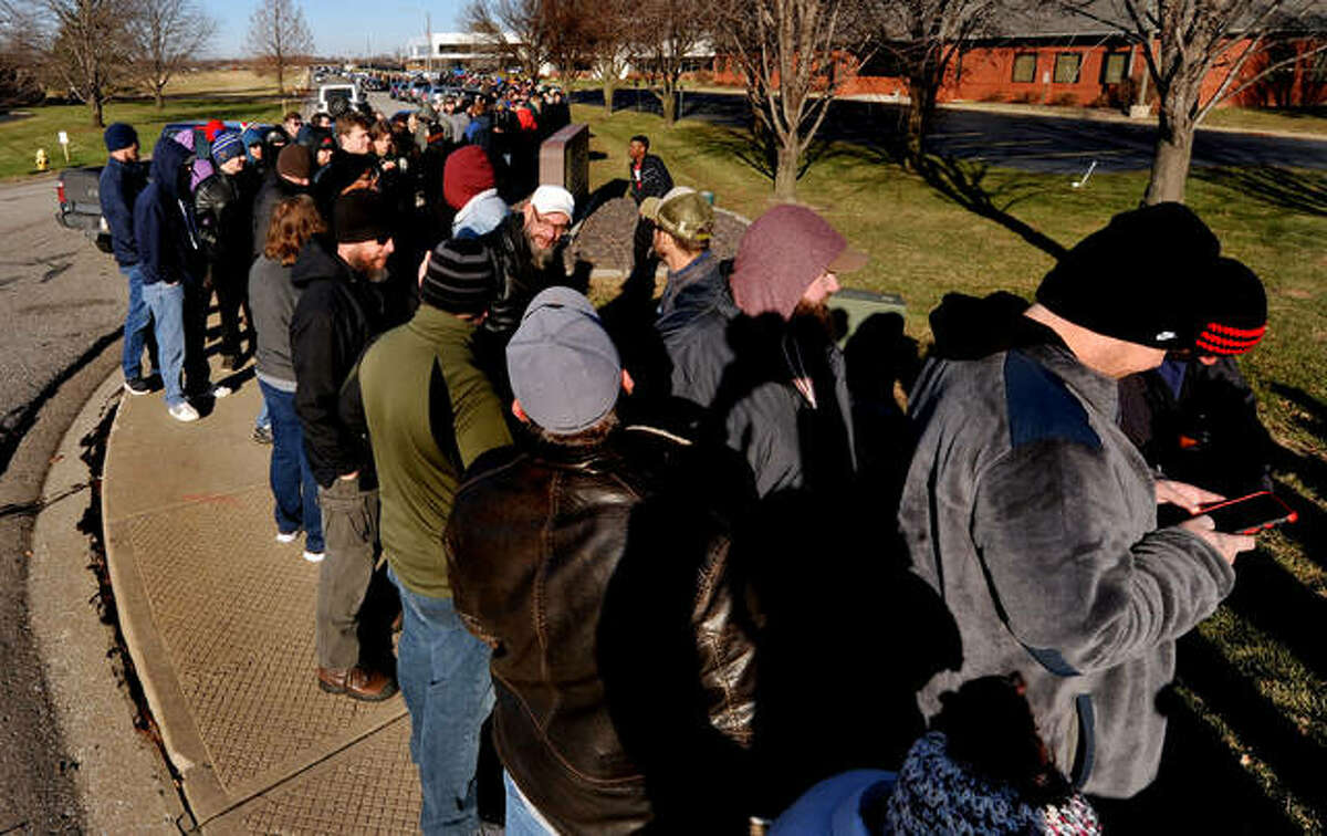 A line stretched for blocks as customers wait to make a legal purchase of cannabis at HCI Alternatives in Collinsville Wednesday.