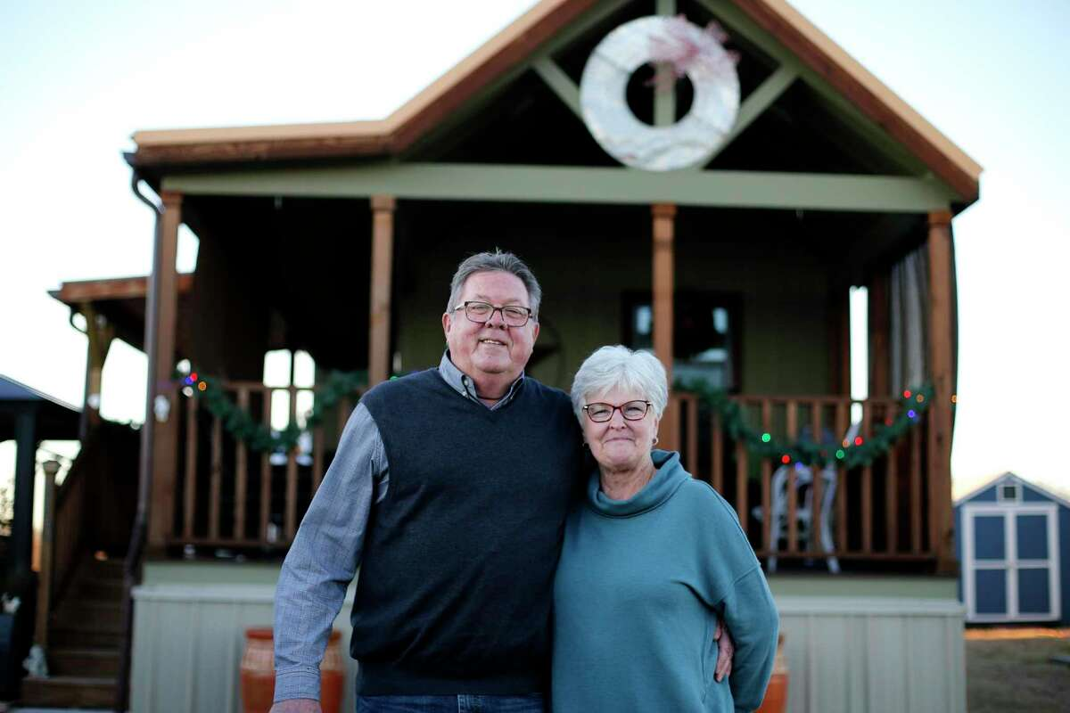 Janet and Lynn Roberts pose for a photo outside their cottage home at Bluebonnet Ridge RV Park & Cottages on Wednesday, Dec. 11, 2019 in Terrell. The couple downsized to the 399-square-foot home and love the