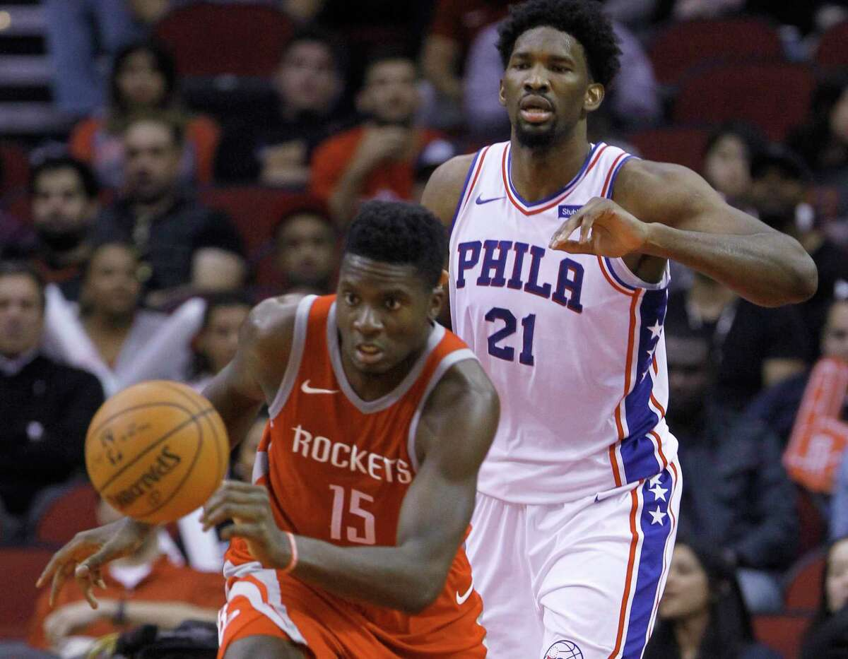 Rockets center Clint Capela (15) runs after a loose ball in front the 76ers' Joel Embiid in an Oct. 30, 2017, matchup won by Philadelphia 115-107 at Toyota Center.