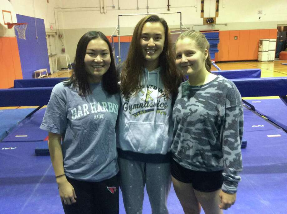 From left to right, Nika Sibley, Celine Perrin and Alexandra Trotman are senior captains of the Greenwich High gymnastics team. Photo: David Fierro /Hearst Connecticut Media
