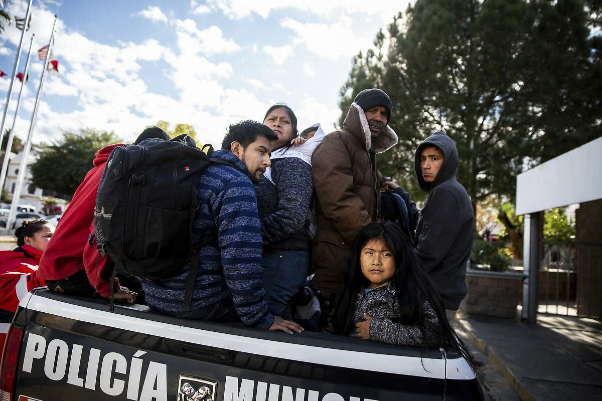 Asylum seekers load into the back of a Mexican police vehicle as they are returned to Nogales, Sonora, Mexico, after making claims in the United States, on Thursday, Jan. 2, 2020. The U.S. government says it has started sending asylum-seekers back to Nogales, Mexico, to await court hearings. Authorities are expanding a program known as Remain in Mexico that requires tens of thousands of asylum seekers to await their immigration court hearings in Mexico. (Josh Galemore/Arizona Daily Star via AP)