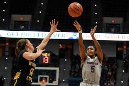 UConn's Crystal Dangerfield, right, makes a basket over Wichita State's Carla Bremaud on Thursday night in Hartford.