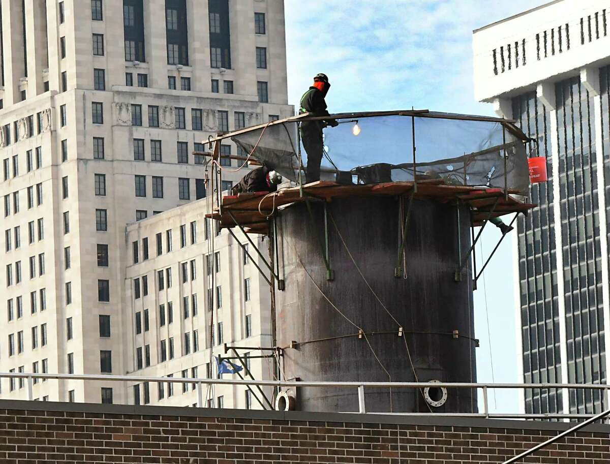 Workers continue to dismantle the smokestack on the former Albany New York Solid Waste Energy Recovery System (ANSWERS) plant on Sheridan Ave. on Thursday, Jan. 2, 2020 in Albany, N.Y. The First Unitarian Universalist Society of Albany assisted in the fight against the continued burning of fossil fuels in the Sheridan Hollow neighborhood. (Lori Van Buren/Times Union)