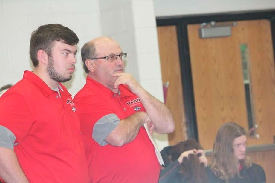Reed City assistant wrestling coach Brett Walker (left) and head coach Roger Steig watch the action at the Big Rapids Invitational earlier this season. (Pioneer photo/John Raffel)