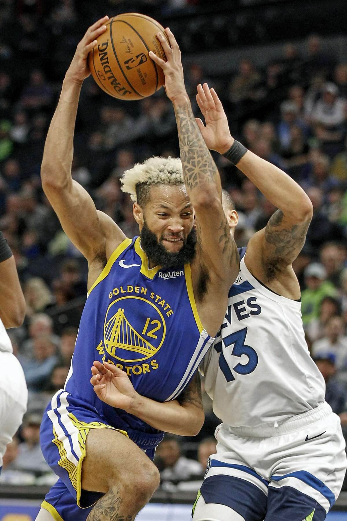 Golden State Warriors guard Ky Bowman (12) drives past Minnesota Timberwolves guard Shabazz Napier (13) in the second half of an NBA basketball game Thursday, Jan. 2, 2020, in Minneapolis. The Timberwolves won 99-84. (AP Photo/Bruce Kluckhohn)