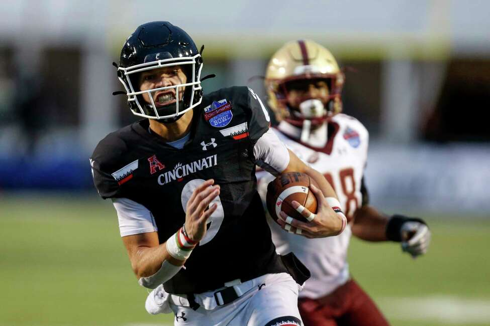 Cincinnati quarterback Desmond Ridder (9) carries the ball for a touchdown against Boston College during the first half of the Birmingham Bowl NCAA college football game Thursday, Jan. 2, 2020, in Birmingham, Ala. (AP Photo/Butch Dill)