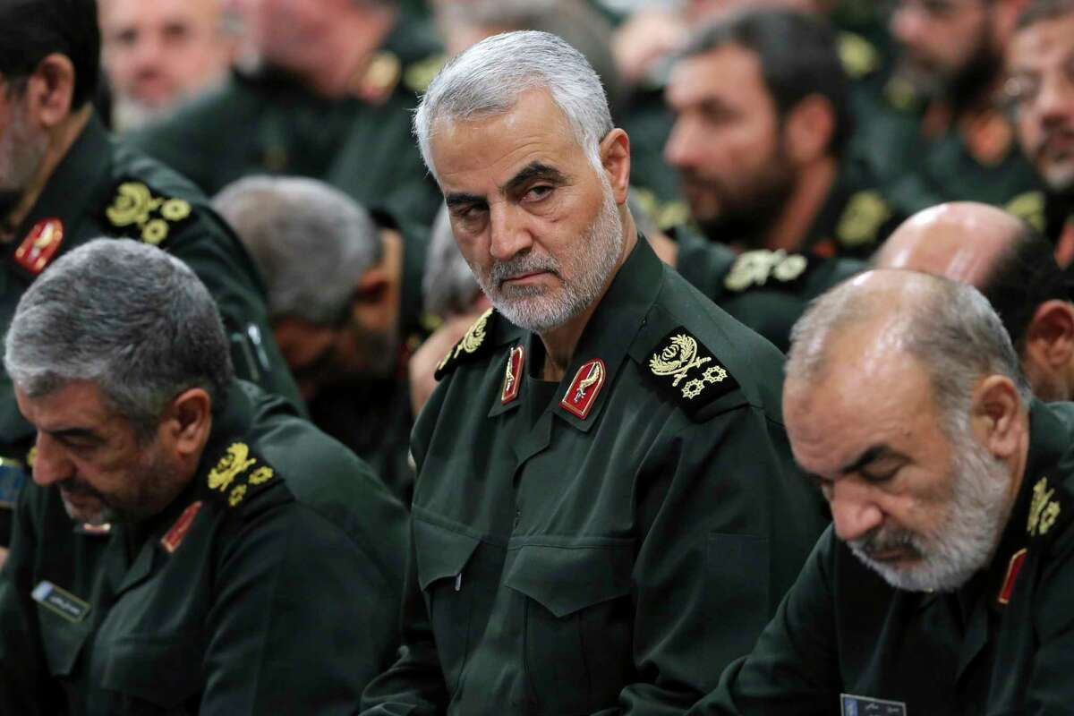 FILE - In this Sept. 18, 2016, file photo provided by an official website of the office of the Iranian supreme leader, Revolutionary Guard Gen. Qassem Soleimani, center, attends a meeting in Tehran, Iran. Iraqi TV and three Iraqi officials said Friday, Jan. 3, 2020, that Soleimani, the head of Irana's elite Quds Force, has been killed in an airstrike at Baghdada's international airport. (Office of the Iranian Supreme Leader via AP, File)