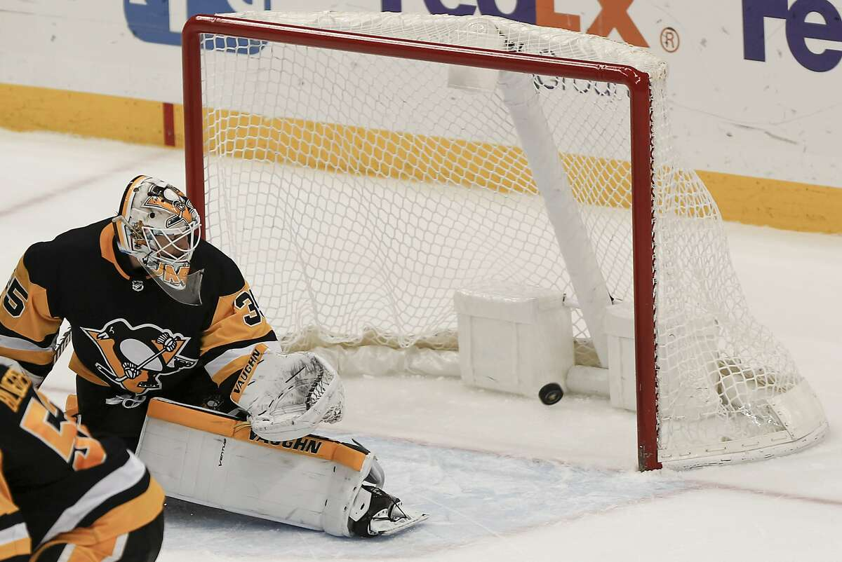 A shot by San Jose Sharks' Brent Burns gets by Pittsburgh Penguins goaltender Tristan Jarry for an overtime goal in an NHL hockey game, Thursday, Jan. 2, 2020, in Pittsburgh. The Sharks won 3-2. (AP Photo/Keith Srakocic)