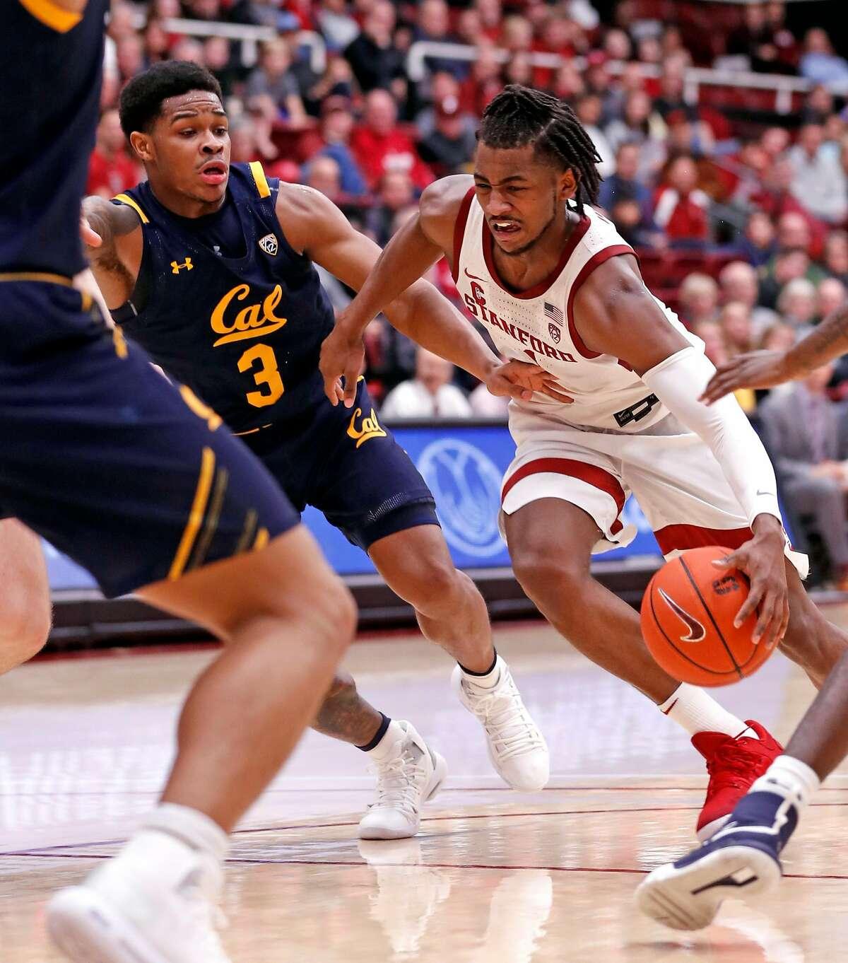 Stanford's Daejon Davis drives against California's Paris Austin in 1st half of Pac 12 men's basketball game at Maples Pavilion in Stanford, Calif., on Thursday, January 2, 2020..