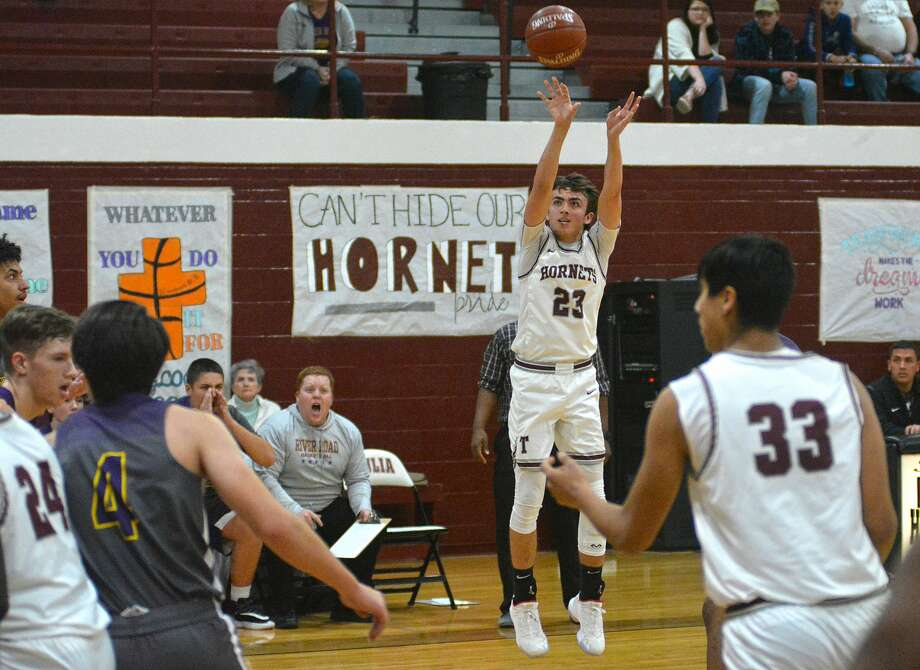 Tulia's Riley Ramos lets a 3-point attempt fly during a District 1-3A boys basketball game against Amarillo River Road on Thursday at Tulia. Photo: Nathan Giese/Planview Herald
