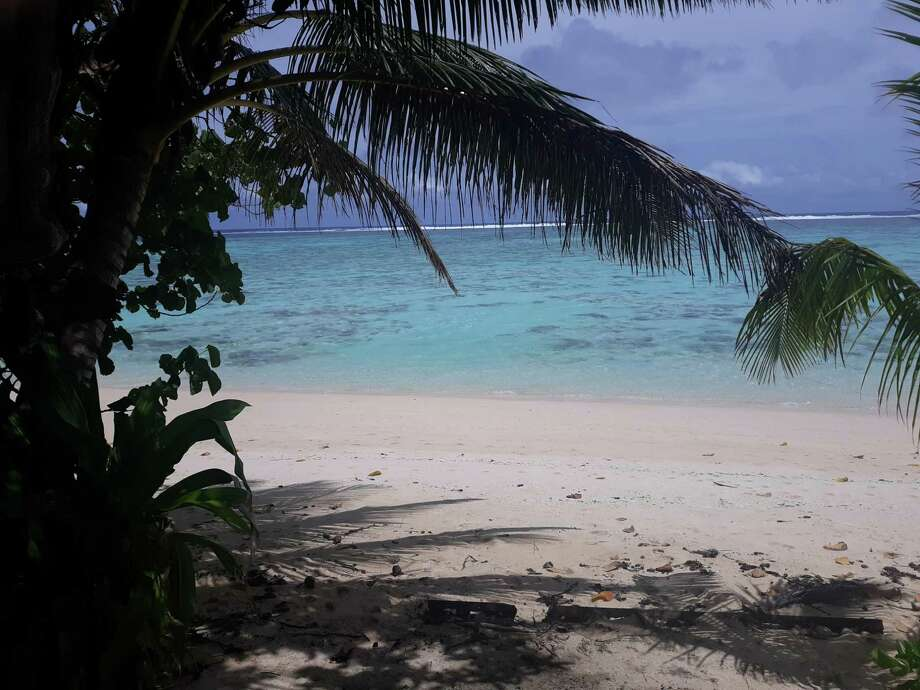 Palm trees and pristine beaches abound on Rarotonga's sparsely-populated south shore. Photo: Photo For The Washington Post By Walter Nicklin. / Walter Nicklin