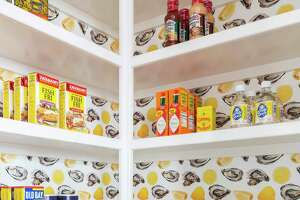 Houston interior designer Courtnay Tartt Elias installed this whimsical wallpaper of oysters and lemon wedges in the kitchen pantry of a client's home.