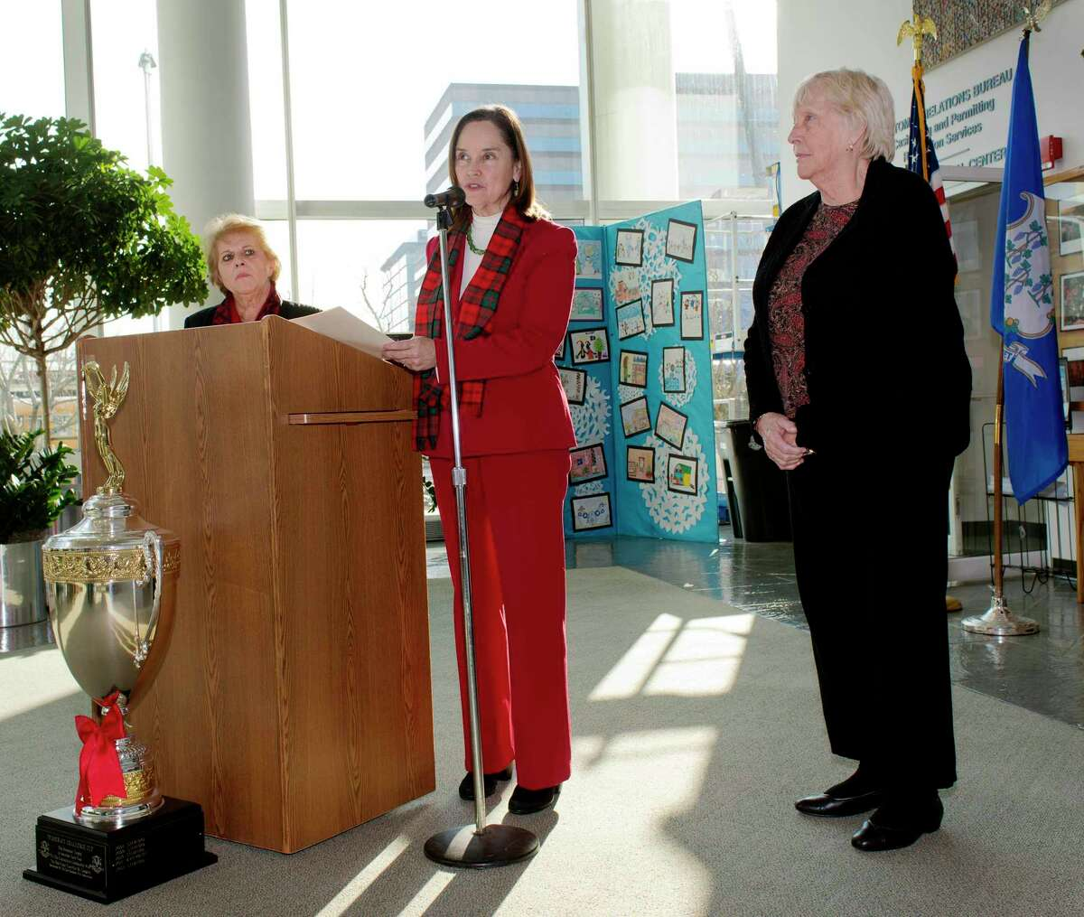 """Denise Merrill, Connecticut Secretary of the State, (center) presents the """"Democracy Cup"""" to Lucy Corelli (left), Stamford CT republican registrar of voters, and Alice Fortunato (right), Stamford CT democratic registrar of voters. The Democracy Cup was awarded to Stamford because they had the highest percentage of voter turnout for a large city on this years election day. The ceremony was held in the lobby of the Government Center, Stamford, CT on Tuesday December 18th, 2012"""