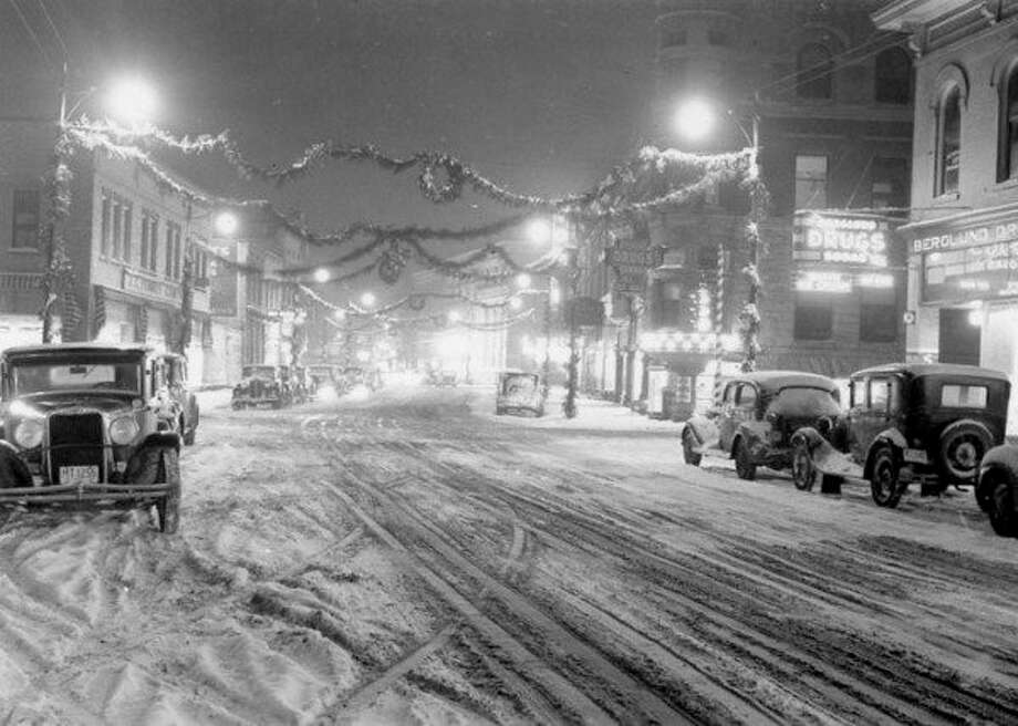 Downtown Manistee looks wintry in this 1930s era photograph. It was a time when there was two-way traffic on River Street.
