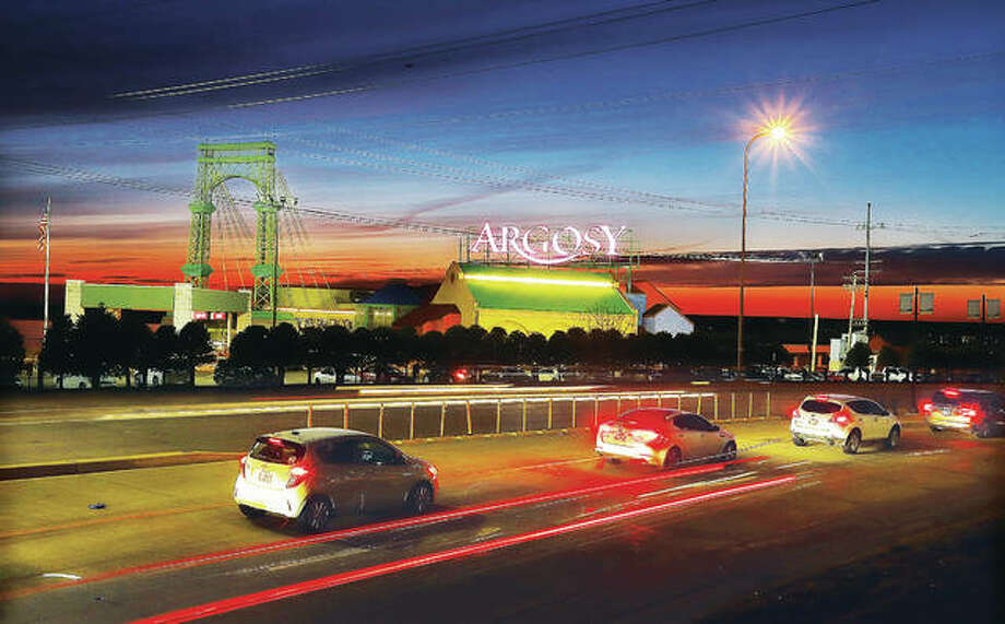 Traffic on Landmarks Boulevard in Alton passes the Argosy Casino Alton at dusk on the riverfront. Gaming revenues on the casino, as well as attendance, are down this year. Spring flooding closed the casino for 45 days between May 3 and June 25.