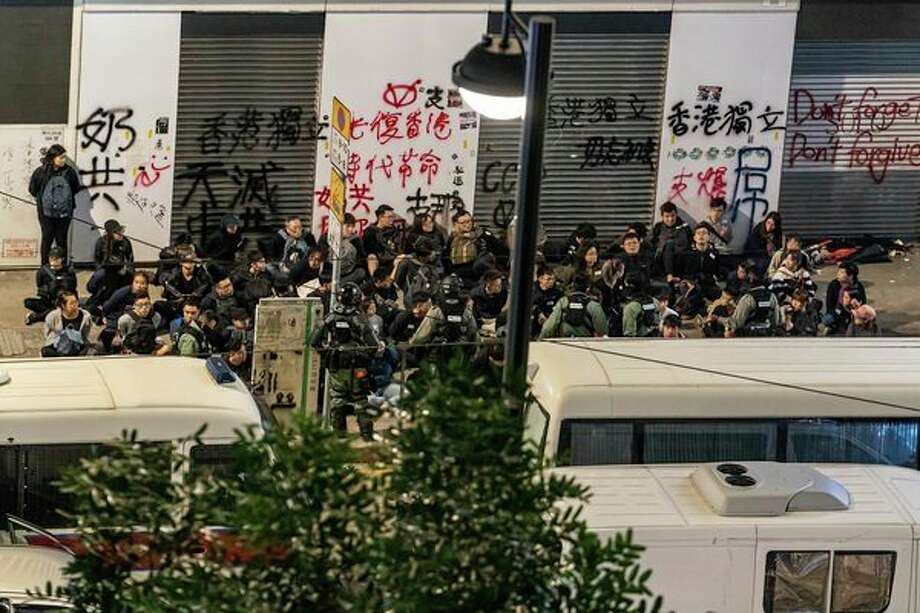 A mass number of protesters are detained by riot police during a rally in Causeway Bay district on New Years Day on January 1, 2020 in Hong Kong, China. (Anthony Kwan/Getty Images/TNS) / Getty Images North America