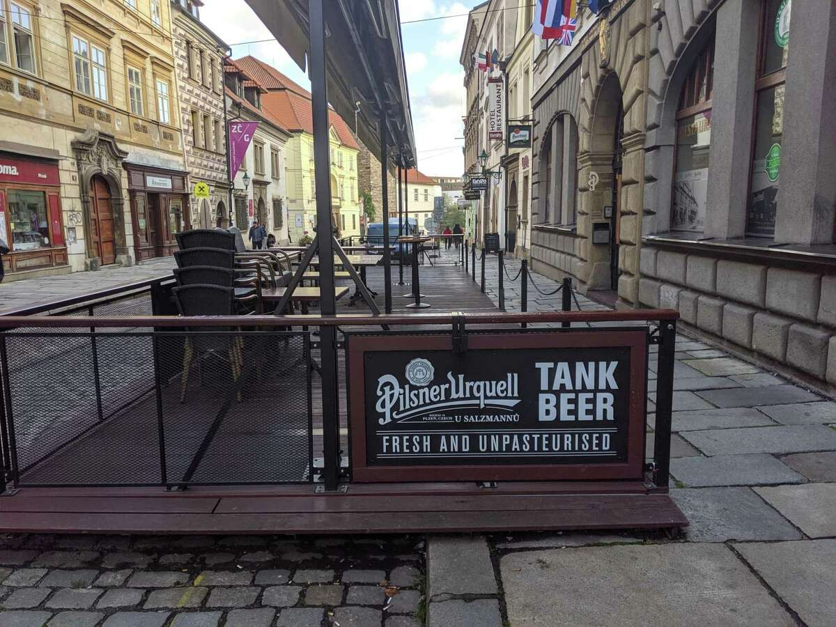 Sign outside restaurant for Tank Beer, fresh and unpasteurized near the main square of the city of Pilsen, Czech Republic.