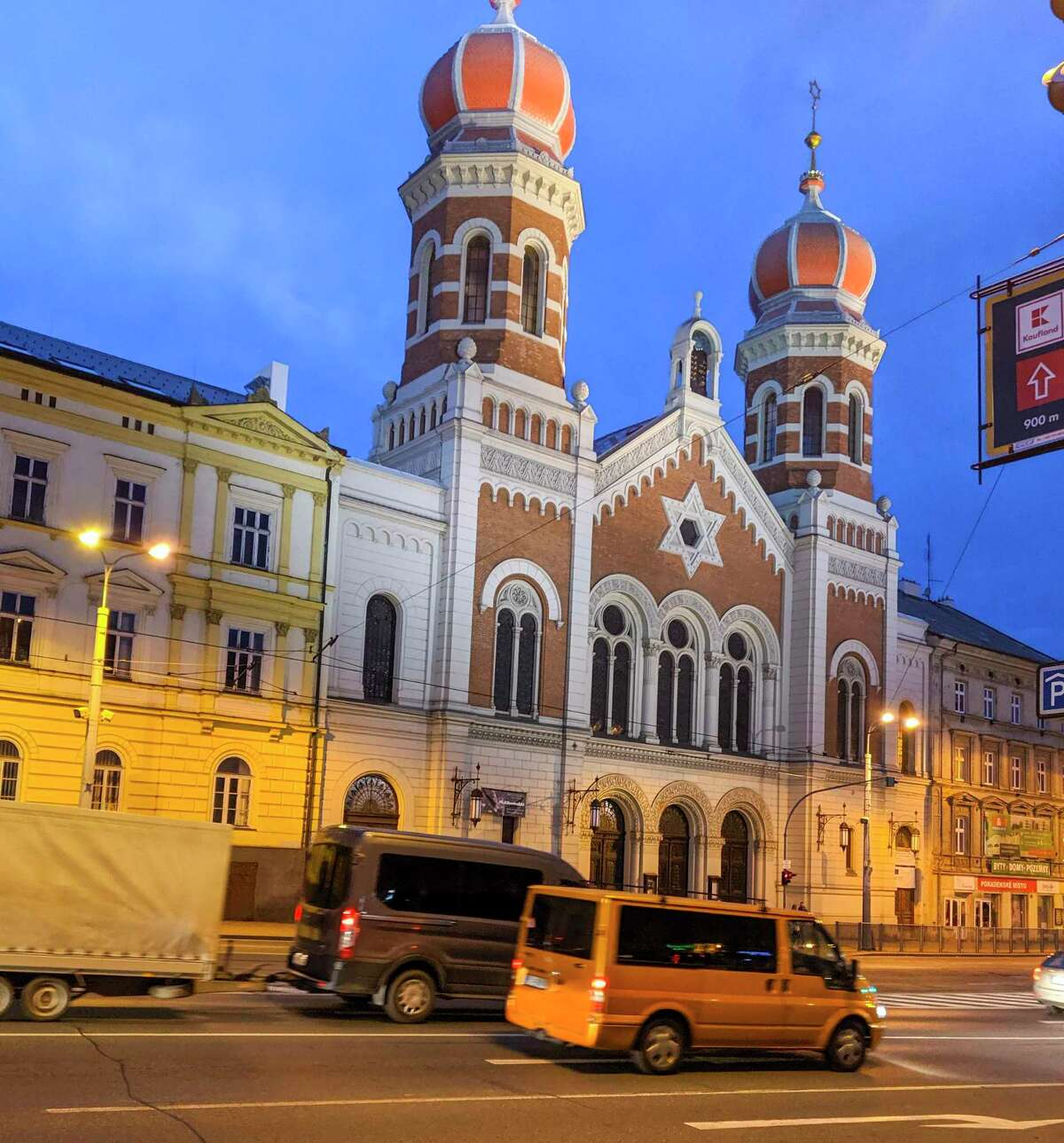 The Great Synagogue of Pilsen, in the Czech Republic, is lit up in the evening light. The synagogue, one of the largest in Europe, was built in 1893 in the Moorish-Romanesque style. German snipers in World War II hid in the parapets. The city's Jewish population was decimated during the war.